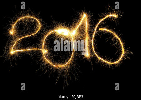 New Year 2016 formed from sparking digits over black background - Stock Photo