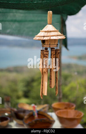 New wood wind bell instrument on a market in Costa Rica - Stock Photo