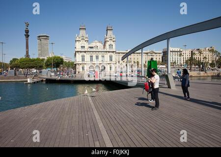 City of Barcelona skyline from Rambla de Mar boardwalk promenade at Port Vell, Catalonia, Spain - Stock Photo