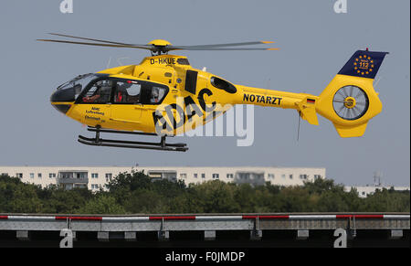 Berlin, Germany. 12th Aug, 2015. A rescue helicopter of ADAC automobile club takes off from the rooftop of an accident - Stock Photo