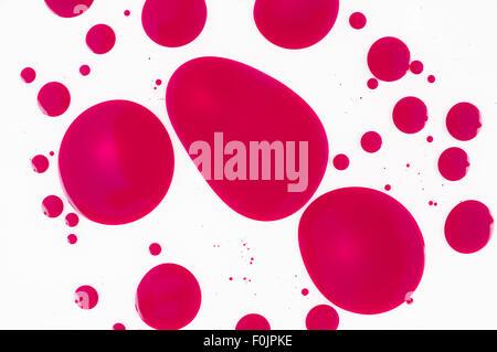 Magenta ink spots in oil - Stock Photo