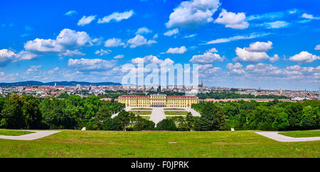 Schonbrunn palace panorama in Vienna, Austria with beautiful blue cloudy sky - Stock Photo