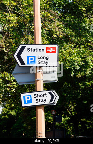 Signs indicating location of car parks and station in Lytham, Lancashire - Stock Photo