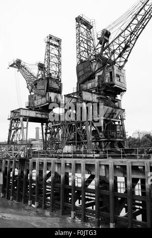 Cranes at Battersea Power Station, London, England, United Kingdom - Stock Photo