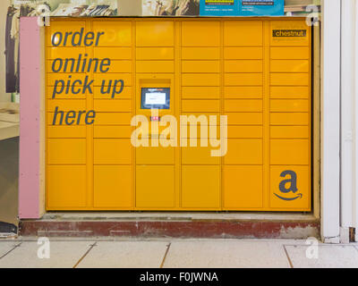 Chestnut an Amazon Locker for delivery of goods ordered on line in a shopping Arcade - Stock Photo