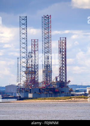 Jack Up drilling rigs Ensco 70 and 102 TERRC Hartlepool  facility on the river Tees for inspection and repair - Stock Photo