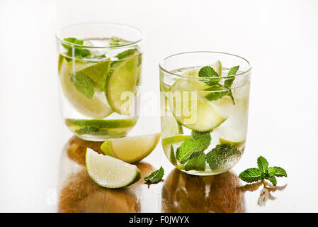 Cold Mojito cocktail on a rustic table. - Stock Photo