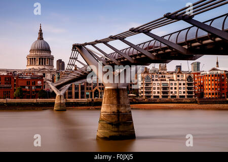 The Millennium Bridge and St Paul's Cathedral, London, England - Stock Photo