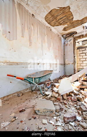Abandoned room under demolition before renovation - Stock Photo