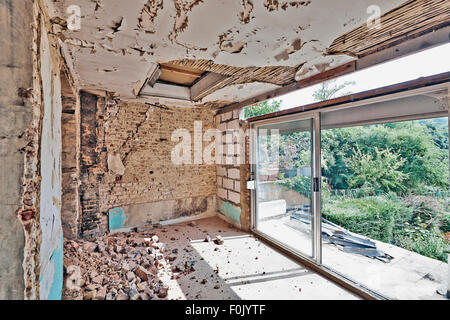 Large abandoned room under demolition before renovation - Stock Photo