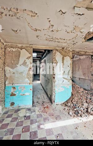 Large abandoned room under demolition before renovation - Stock Photo