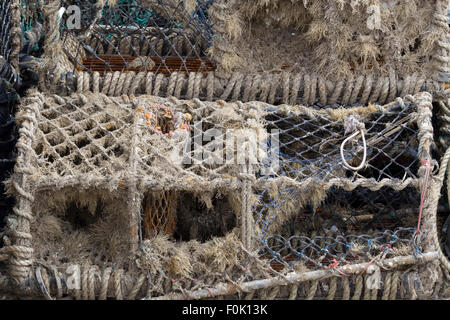 Broken Lobster and crab baskets on the jetty in Whitby north Yorkshire - Stock Photo