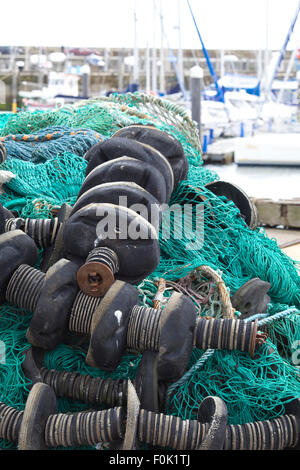 nets and flotation devices for fishing boats on the harbor at whitby - Stock Photo