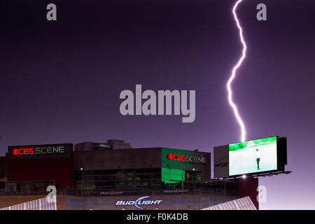 August 15, 2015; Foxborough, MA, USA; A lightning bolt flashes behind the screen at CBS Scene. The MLS game between - Stock Photo