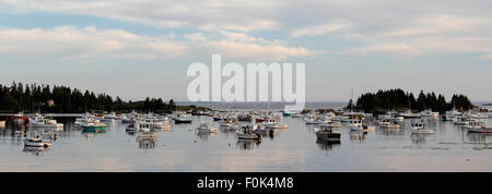 Lobster boats on moorings in harbor waterfront Vinalhaven Island Maine New England USA - Stock Photo