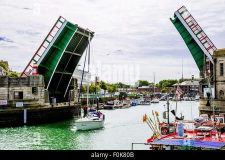 Bridge opening for sailing yacht at Weymouth bridge, Weymouth Marina, Weymouth and Portsmouth, Dorset, - Stock Photo