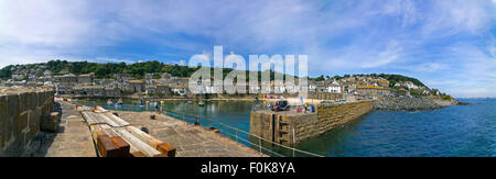 Horizontal panoramic (4 picture stitch) view of Mousehole in Cornwall. - Stock Photo