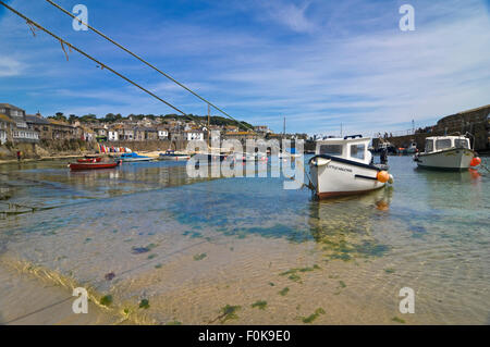 Horizontal view of high tide in Mousehole, Cornwa - Stock Photo