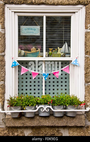 Vertical view of a decorative window in Mousehole, Cornwall - Stock Photo