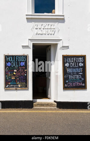 Vertical view of colourful blackboards outside a - Stock Photo