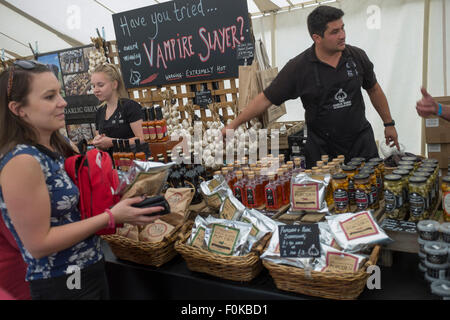 Stalls selling chilli and garlic oils at Isle of Wight Garlic Festival - Stock Photo