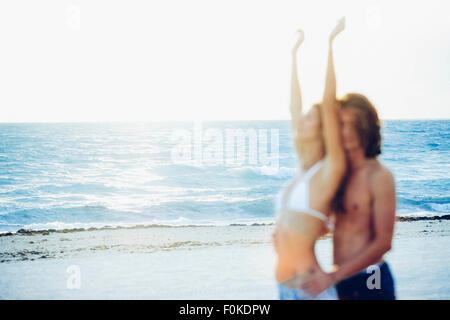 USA, Miami, view to the sea with blurred couple in the foreground - Stock Photo