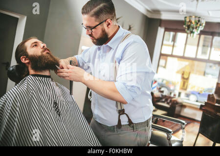 hairdresser cutting beard of his customer with scissors and shave in stock photo royalty free. Black Bedroom Furniture Sets. Home Design Ideas