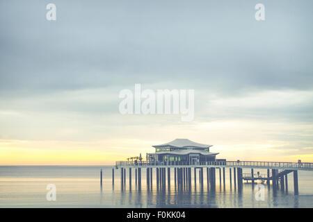 Germany, Niendorf, view to sea bridge with tea house at sunrise - Stock Photo