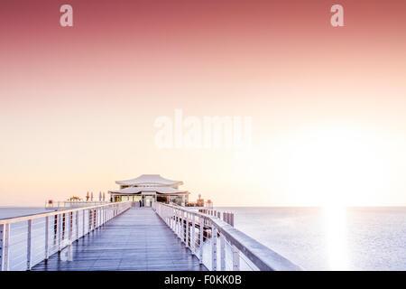 Germany, Niendorf, sea bridge with tea house at sunrise - Stock Photo