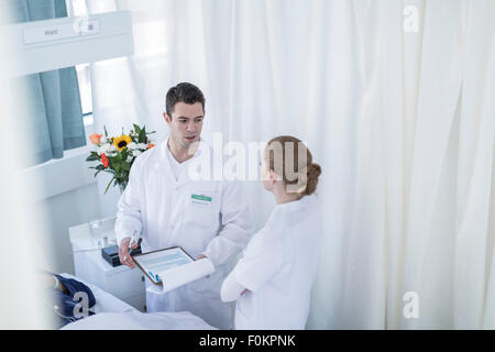 Doctor and nurse in a hospital room - Stock Photo
