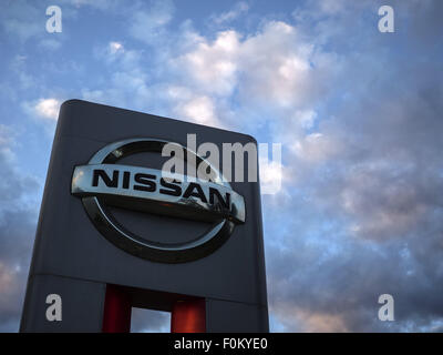 Moscow, Russia. 15th Aug, 2015. Aug 15, 2015: Nissan logo against evening sky. Nissan Motor Company Ltd is a multinational - Stock Photo