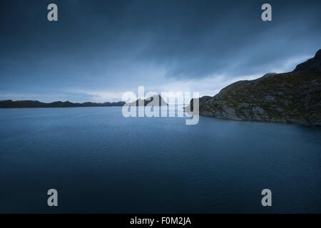 Mystical, foggy evening mood in a fjord, Norway - Stock Photo