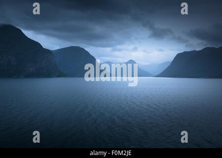 Foggy Evening Mood in the Sognefjord, Norway - Stock Photo