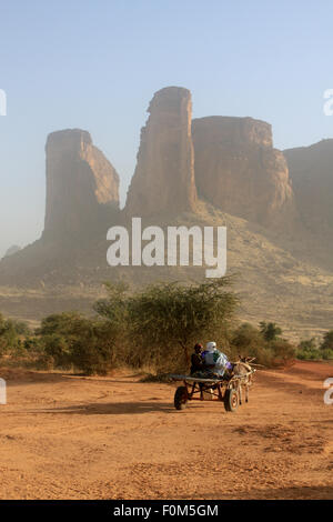 BANDIAGARA, MALI - SEPTEMBER 30, 2008:  African family on a cart pulled by a donkey in the desert in bandiagara - Stock Photo