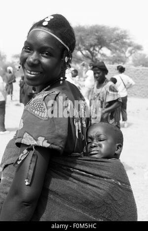BANDIAGARA, MALI - SEPTEMBER 30, 2008:  Unidentified woman with her baby in bandiagara in the Mopti region in Mali - Stock Photo