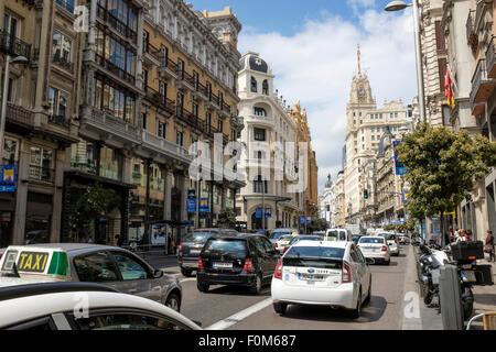 Busy traffic on the Gran Vía, in the Spanish capital city of Madrid. - Stock Photo