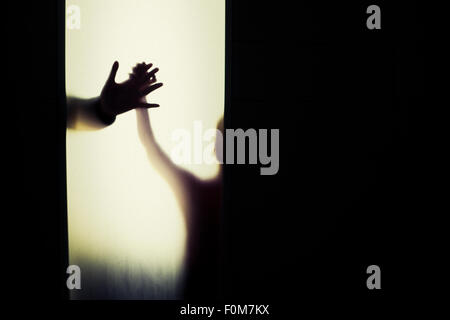 Silhouette of child and adult holding hands. Conceptual image of trust, connection and bonding. - Stock Photo