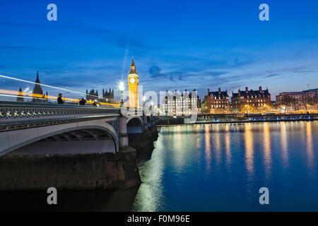 Westminster Bridge and the Neo-gothic Houses of Parliament by Charles Barry and Augustus Pugin, at night time - Stock Photo