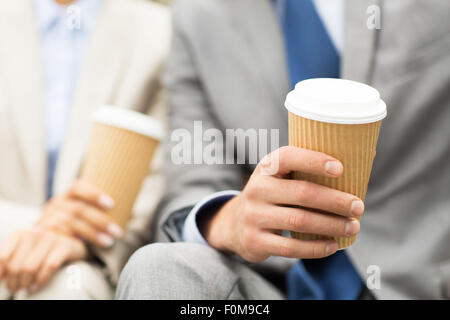 close up of business people hands with coffee cups - Stock Photo
