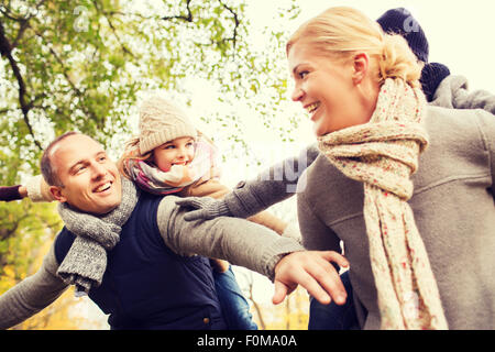 happy family having fun in autumn park - Stock Photo