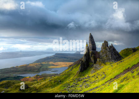 The Old Man of Storr rocks on Trotternish ridge on northern Skye island showing the Loch Leathan lake, the Inner - Stock Photo