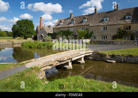 Stone bridge and cotswold cottages by the River Eye, Lower Slaughter, Cotswolds, Gloucestershire, England, United - Stock Photo