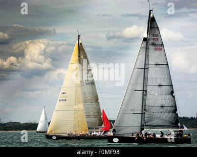 Pictured at the start of the Fastnet race 2015 at Cowes is Germany's Leu1 and British Noonmark VI1 - Stock Photo