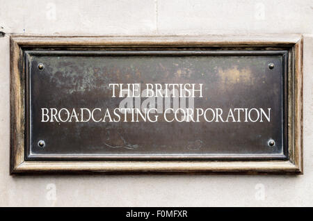 The sign for The British Broadcasting Corporation on the wall of Broadcasting House, Langham Place, London, England, - Stock Photo