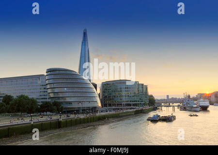 The Shard, City Hall (HQ of the Mayor of London) and the Thames river in London at sunset - Stock Photo