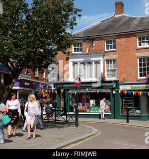 Leominster Herefordshire shoppers in Corn Square in summer August UK - Stock Photo