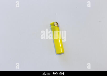 yellow Lighter isolated on white - Stock Photo