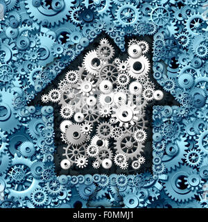 Real estate business concept as house or home automation made of gears and cog wheels as a symbol for investing - Stock Photo