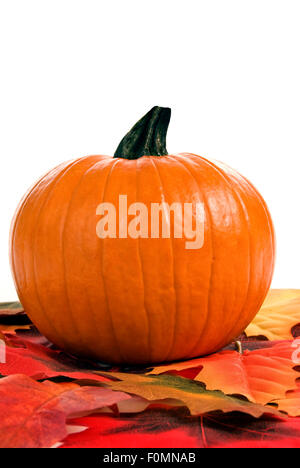 It's the season for pumpkins and Autumn leaves - Stock Photo