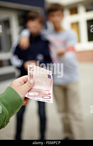 Extortion on the playground - Stock Photo